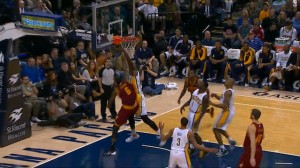 Earl Clark drives past the defense and goes up for the dunk, but Roy Hibbert emphatically denies him.